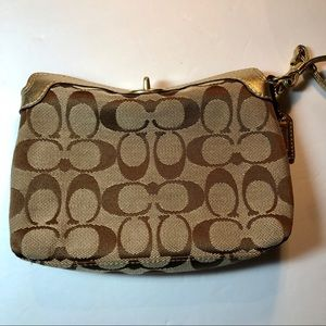 Coach top closing wristlet with gold trim